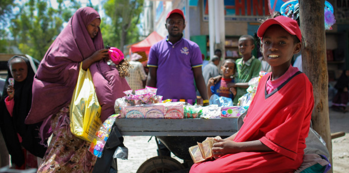 Woman shops at a road side stall in Hamar Weyne market, Mogadishu.