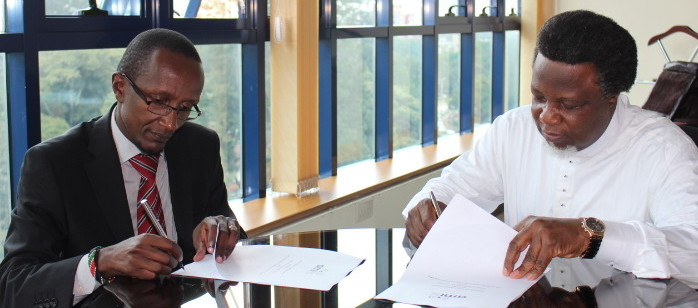AMI's CEO Eric Chinje and LDRI's Executive Director Muchiri Nyaggah signing an agreement on partnership between the two institutions